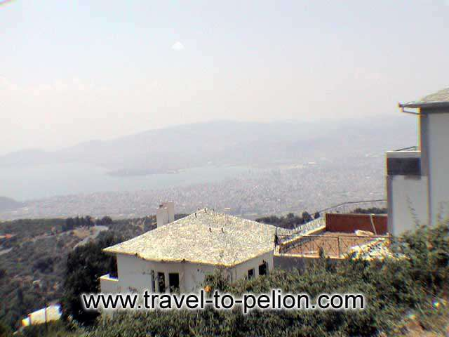 PORTARIA - A traditional house and Volos in the background