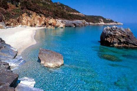 MILOPOTAMOS BEACH - A group of rocks divides the impressive white pebbled beach of Mylopotamos into two. A passage through the rocks connects the two beaches. On the other side of Mylopotamos the waters of the stream reach the sea and make the scenery wilder.